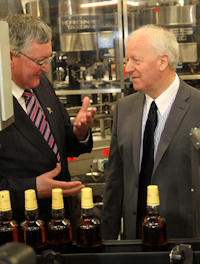 Mr Ewing at the BenRiach bottling line and in conversation with Mr Walker