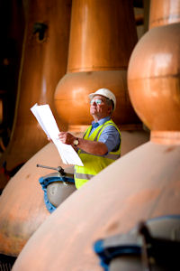 Operations manager Hamish Proctor looks over plans by Chivas Brothers to reopen Glen Keith Distillery in Speyside