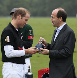 The Duke of Cambridge is givin a bottle of Royal Salute