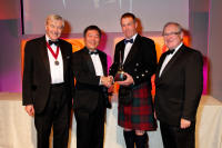 Alan Winchester and Desmond Payne collect the Distiller of the Year Award at the IWSC