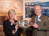 Jim Royan, Festival Chairman presenting Ann Miller with the Spirit of Speyside Whisky Festival Quaich at the Festival's Annual General Meeting, Knockando Distillery on 2nd October 2009.