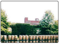 A photo looking over the whisky barrels toward the A. Smith BowmVirginia