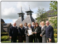 A photo of Strathisla Distillery receiving its  award for a  Five Star visitor center status by Visit Scotland, the country's official national tourism organisation.