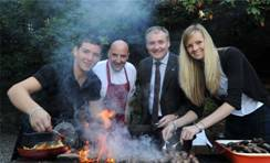 Callum McNicoll of Glengoyne Distillery, Chef Tom Lewis of Monachyle Mhor, Rural Affairs Secretary, Richard Lochhead and Stephanie Kennedy of Glengoyne Distillery barbeque some sausages made with 17 Years Old Glengoyne Whisky