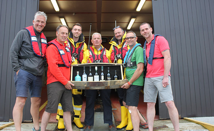 Group of seven malt whiskies from each of Islay's coastal distilleries Goes Under The Hammer for RNLI