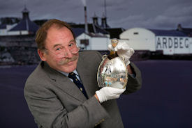 Charles MacLean with the rare 1974 Ardbeg, in bottle designed by Maeve Gillies